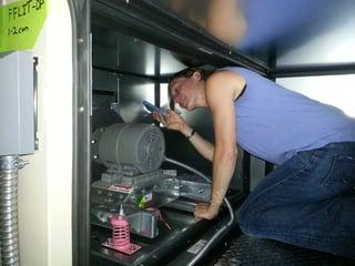 Katie_Inspects_HVAC_Equipment.jpg